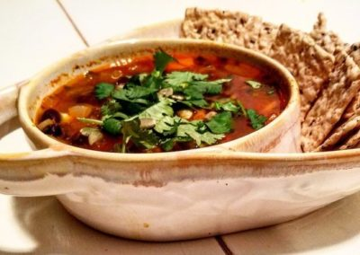 Black Bean Soup topped with Cilantro and Toasted Pumpkin Seeds